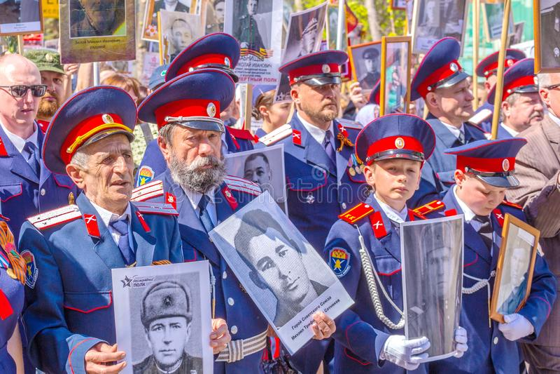 Starszy kozaczkowie z portretami weterani wojenni w akcji fotografia royalty free