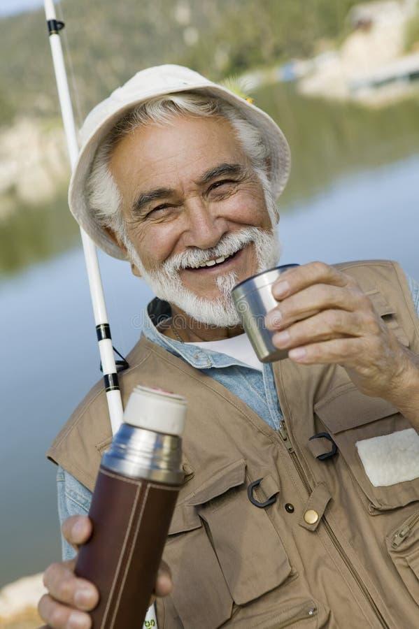 Starszy mężczyzna Ma kawę fotografia stock