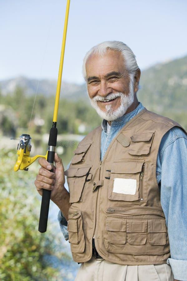 Starszy mężczyzna Z połowem Rod zdjęcie stock