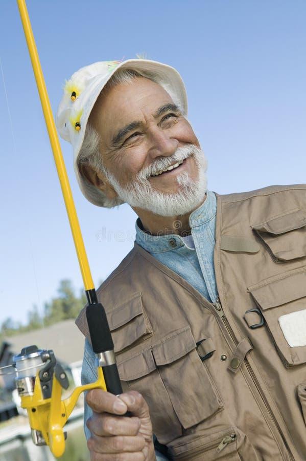 Starszy mężczyzna Z połowem Rod obrazy royalty free