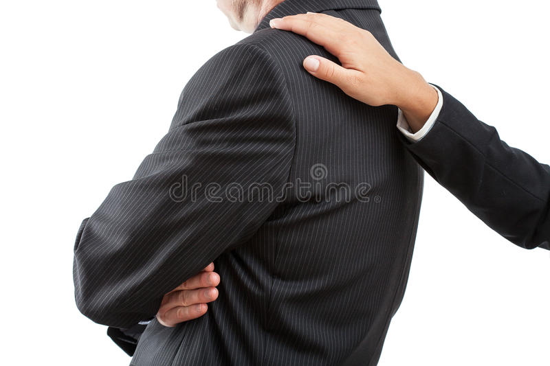 Start of apology. One of two workers is starting to solve their conflict stock photography