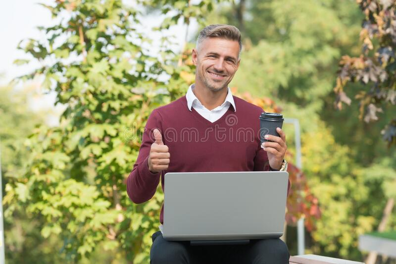Start blog on best blogging platform. Happy blogger show thumbs up outdoor. Man write blog from laptop. Blog post. Coffee blog you need to read. Coffee boosts royalty free stock images