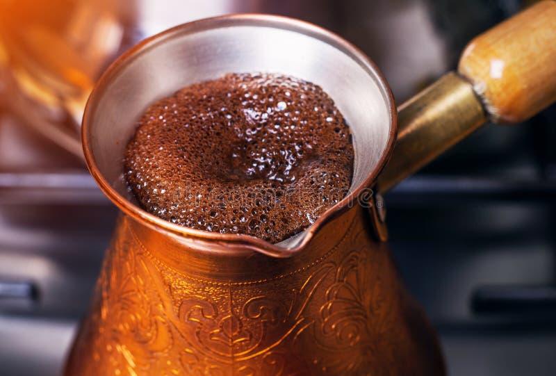 Start boiling coffee. Fragment start boiling organic coffee stock photo