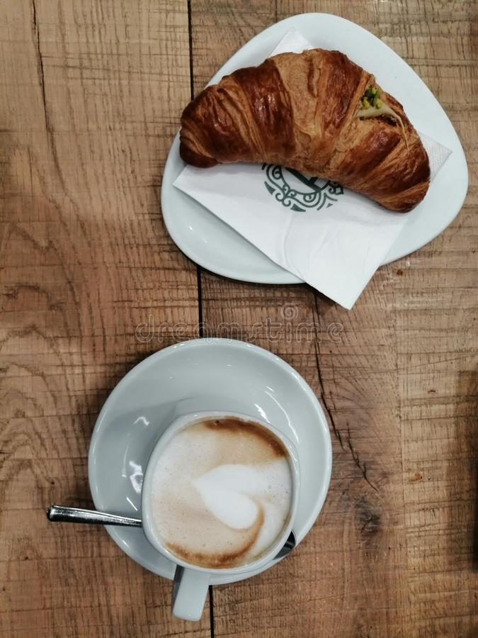 Start the day with a beautiful cappuccino and Brioches royalty free stock photography