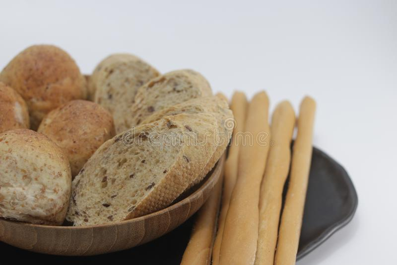 Baguette, whole wheat bread , Italian Bread Sticks, Grissini , on White Background. Start a day with healthy food, good to be a light meal, served with Butter stock image