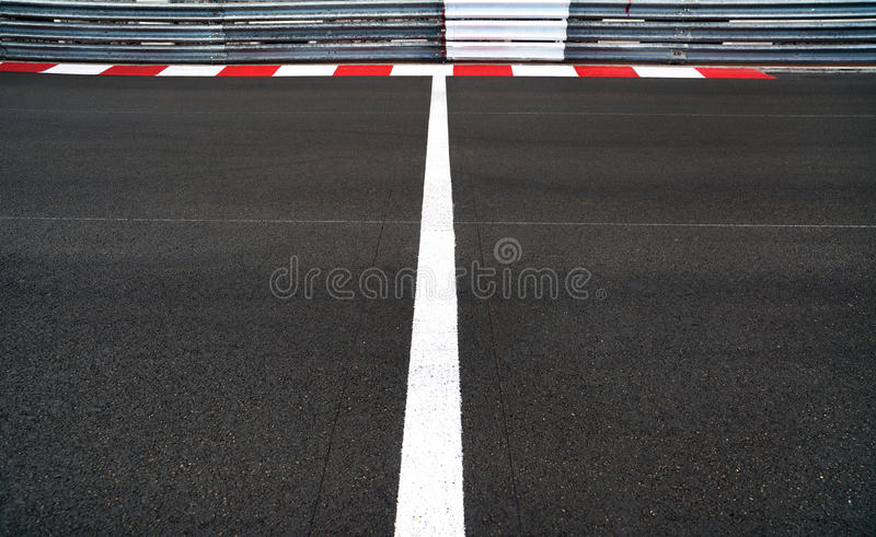 Start and Finish line in motor race asphalt Grand Prix track and. Start and Finish motor race line asphalt on Grand Prix street circuit. Red and white curb stock image