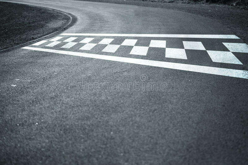 Start finish line on windy asphalt road royalty free stock photos