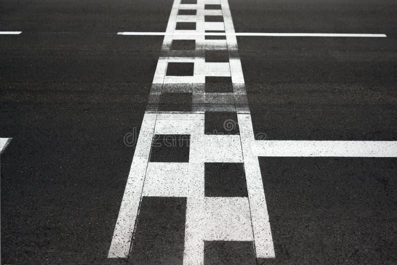 Start and Finish race line asphalt Monaco Grand Prix circuit. Start and Finish motor race line asphalt on Monaco Montecarlo Grand Prix street circuit royalty free stock images