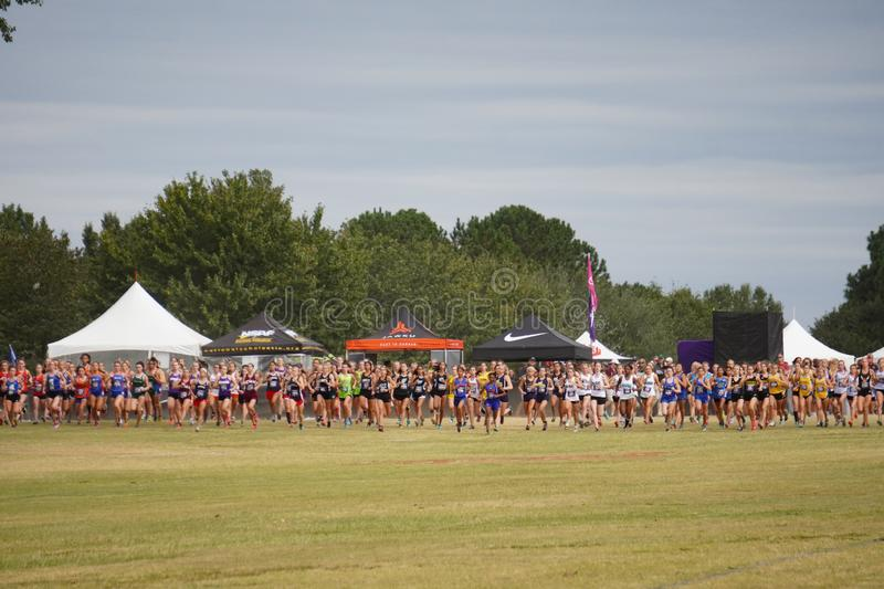 Athletes running at start of the Girls 5k CC Blue race at the Great American Cross Country Festival in Cary, NC, October 5, 2019 stock image