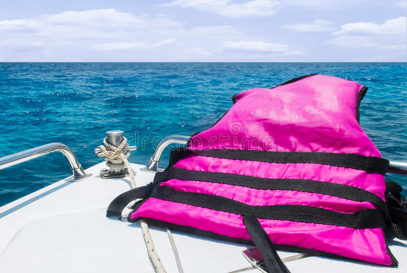 Start Journey to The Sea with Safety Concept, View of Speed Boat with Life Vest Moving with Seascape and Sky with Cloud in. View of Speed Boat with Life Vest royalty free stock photo