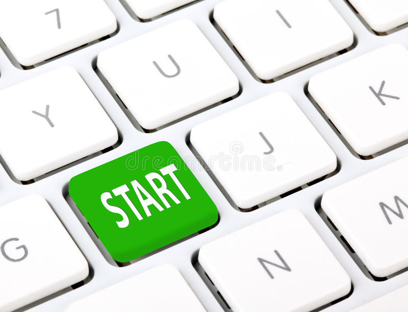 Start on keyboard. White keyboard with green button, spelling start