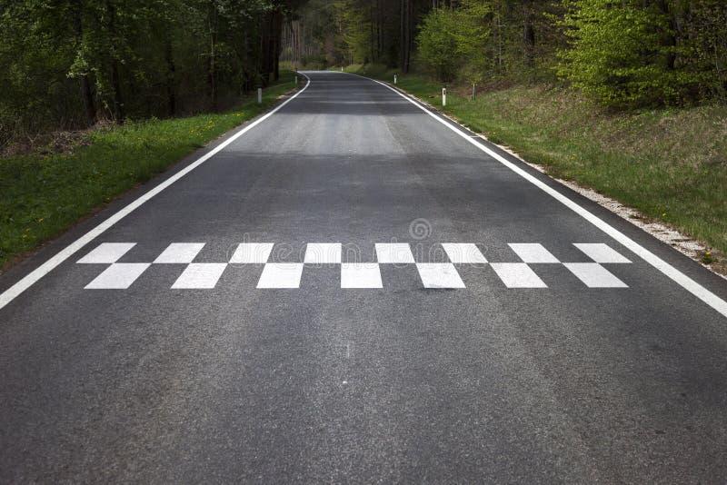 Start line patter on the countryside asphalt floor stock image