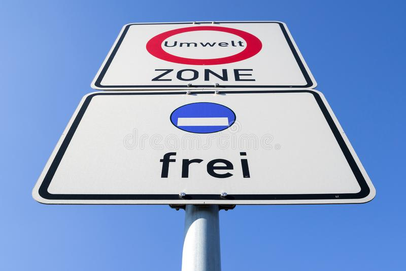 Start of a low-emission zone. German road sign: start of a low-emission zone, vehicles with fictive blue low-emission zone sticker permitted stock photo