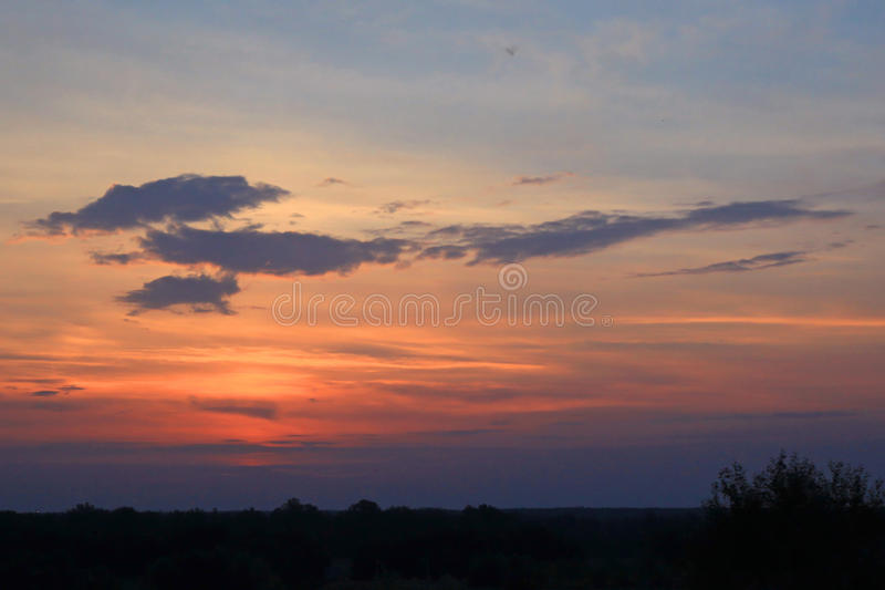 Start of the meeting before sunrise. Morning sunrise at sunrise,nThe rising sun in the clouds stock photo