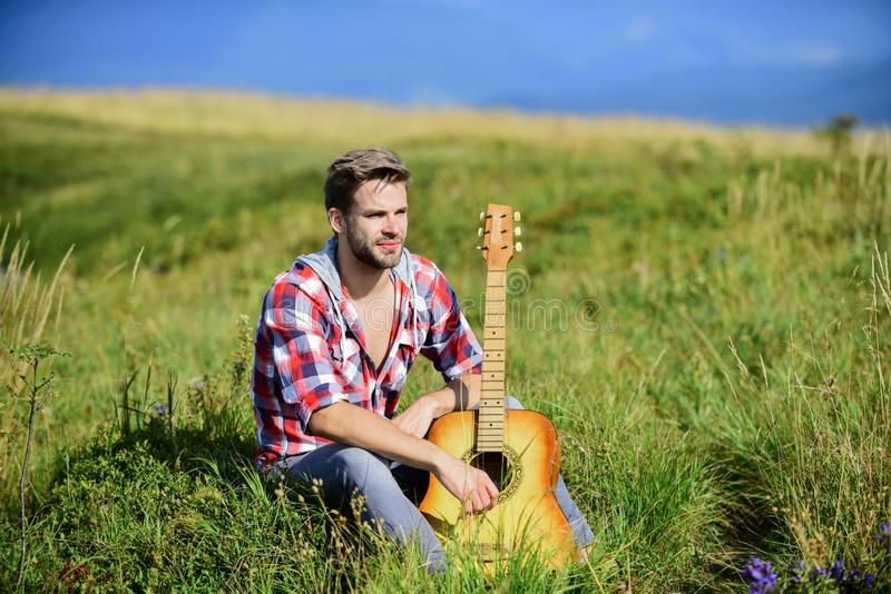Start the music. sexy man with guitar in checkered shirt. cowboy man with acoustic guitar player. country music song stock image
