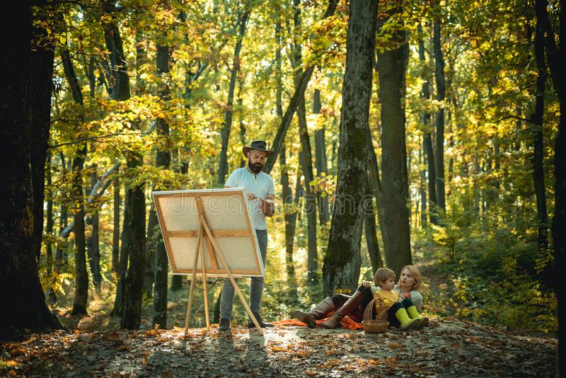 Start new picture. Capture moment. Beauty of nature. Bearded man woman and son relax autumn nature. Drawing from life. Painter artist with family relaxing in stock photo