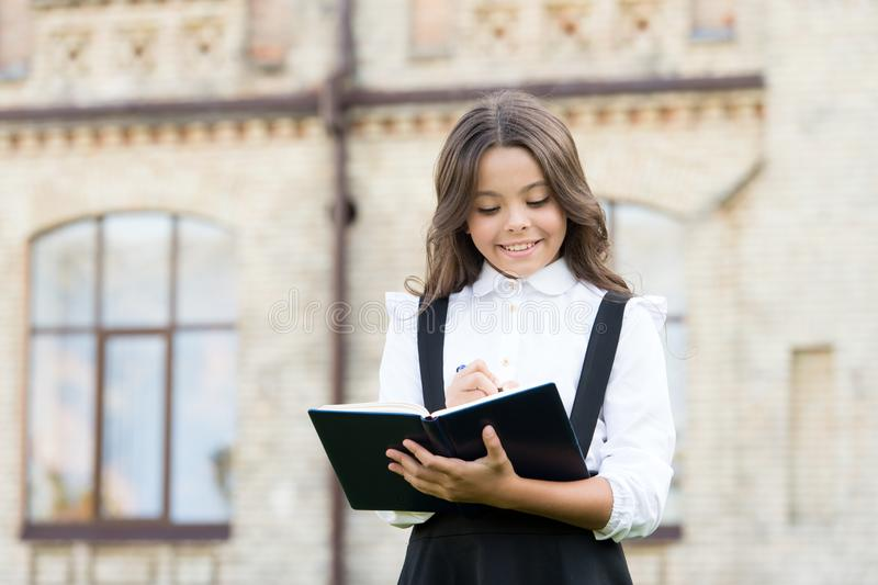Start new school project. Welcome back to school. School girl formal uniform hold book. Towards knowledge. Students life royalty free stock images
