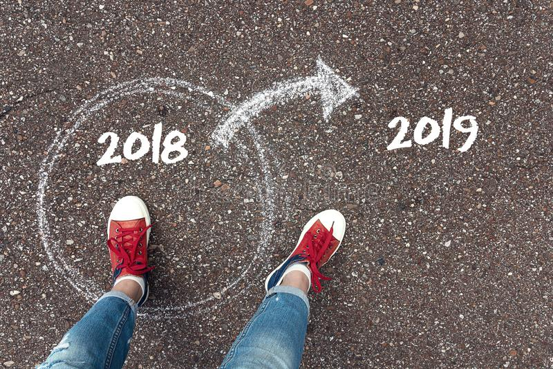 Start new year 2019 and leaving behind old year. Concept for success and passing time. stock photography