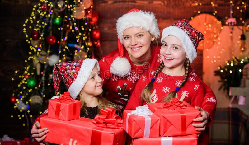 The start of the new year. Mother and daughters on Christmas day. Mother and children with Christmas gifts. Happy family royalty free stock photography