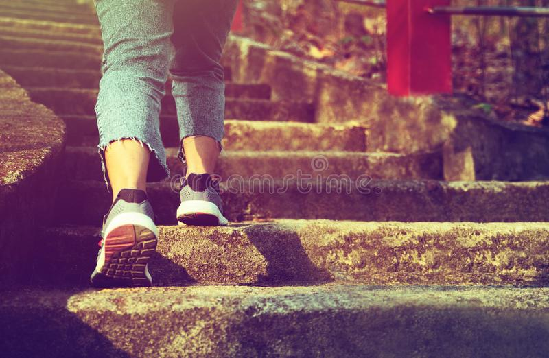 start into the new year.Start of woman walking up stairs,with sunset light.Goal of Success royalty free stock photo