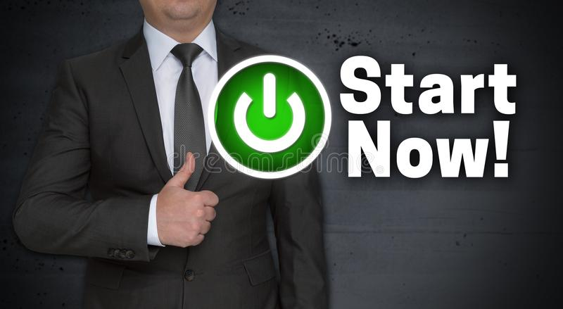 Start Now concept and businessman with thumbs up stock photos