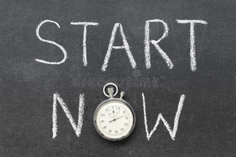 Start now. Concept handwritten on chalkboard with vintage precise stopwatch used instead of O royalty free stock photo