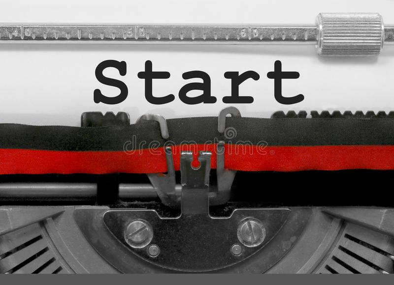 Start by the old typewriter on white paper. Start text written by an old typewriter on white sheet royalty free stock image