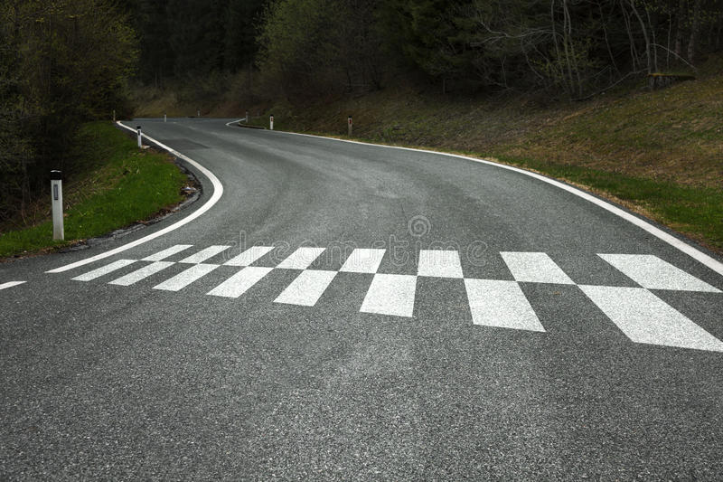 Start pattern on the country road. Start pattern on the winding curved asphalt country road stock image