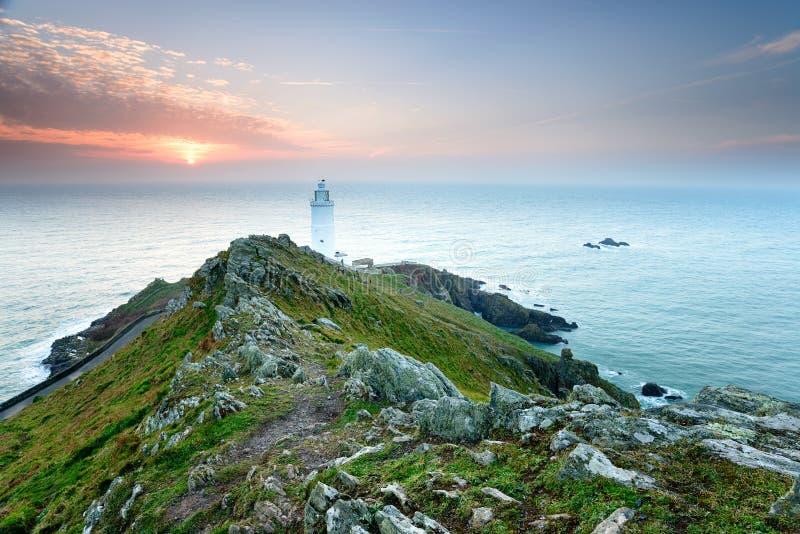 Start Point Lighthouse in Devon. Sunrise over the lighthouse at Start Point on the Devon coast royalty free stock photo
