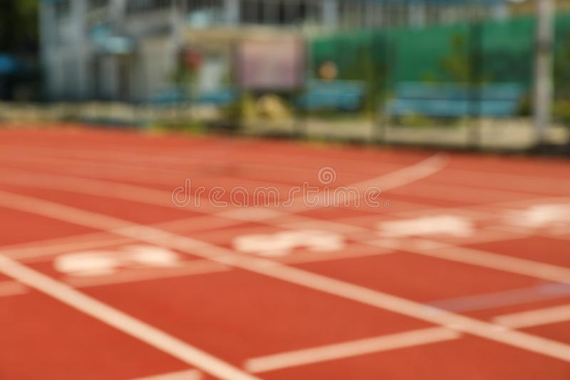 Start of red athletic track with numbers royalty free stock images