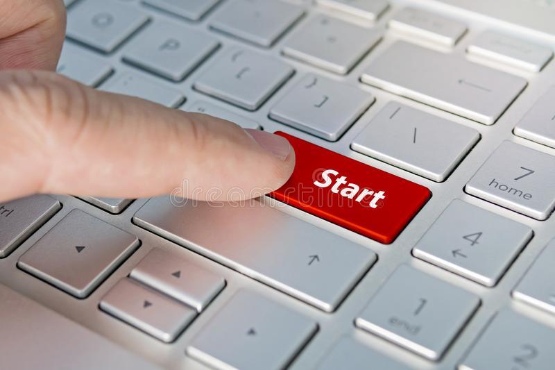 START on Red Enter Button on black keyboard. Red button stock images