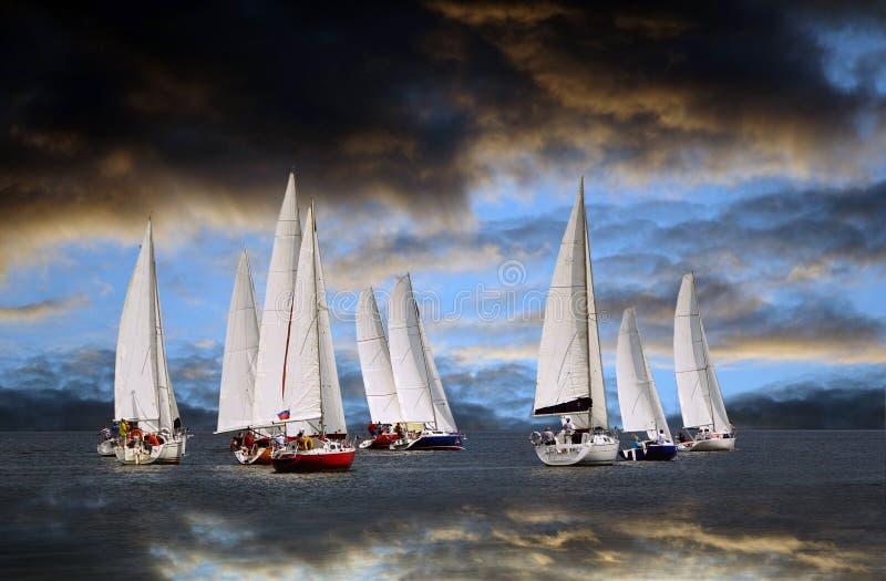 Start of a sailing regatta.The storm cloud. stock photo