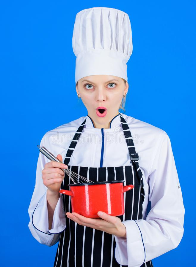 Start slowly whisking or beating cream. Use hand whisk. Kitchen utensils concept. Best whipping techniques. Woman chef. Hold whisk and pot. Whipping like stock photos