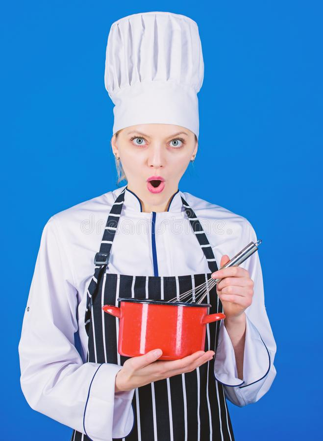 Start slowly whisking or beating cream. Use hand whisk. Kitchen utensils concept. Best whipping techniques. Woman chef. Hold whisk and pot. Whipping like stock photography
