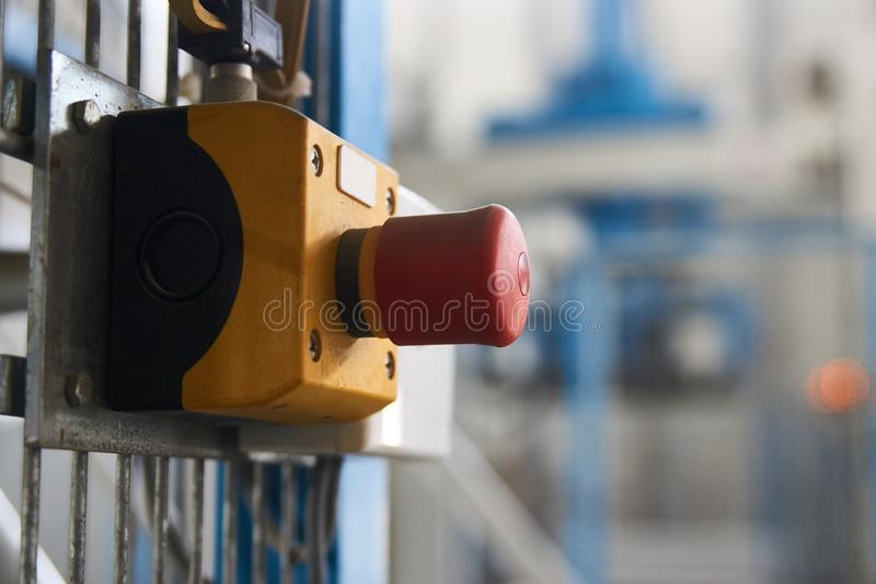 Start or stop button for industrial machine, close-up. Emergency Stop for Safety concept. Red emergency stop switch and green reset button in factory stock image