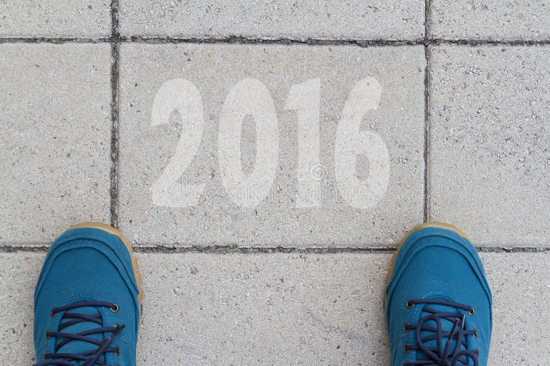Start to new year 2016 - top view of man walking on the road stock photography