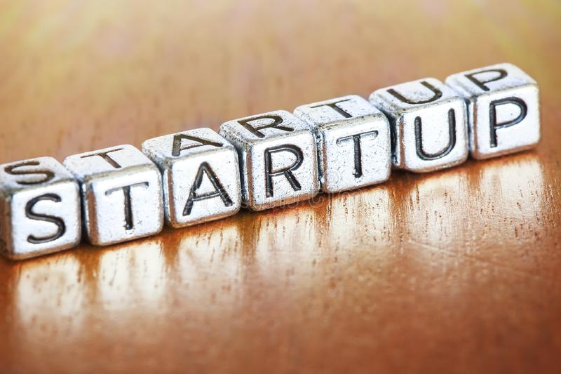 Start up business finance concept with metal letters stock image