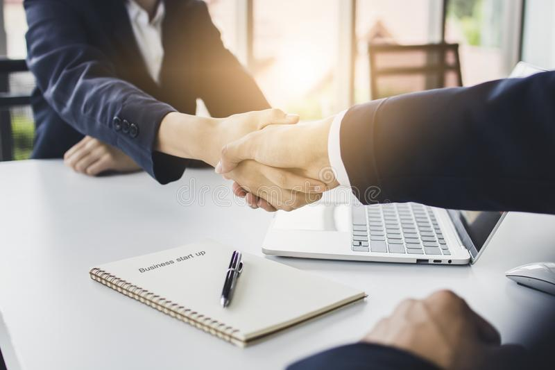 Start up business people shake hands with investor before negotiating and planning to invest company together. In office royalty free stock image