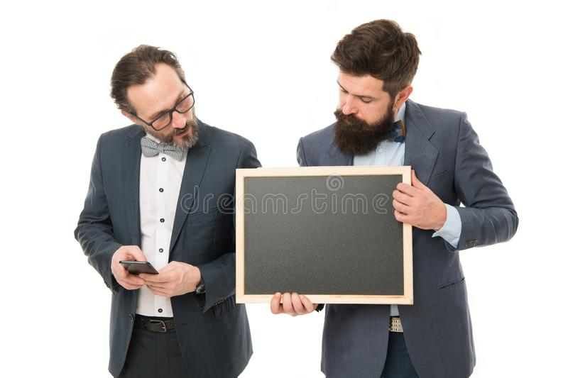 Start up business project. Launching business project. Men bearded guys wear formal suits hold blackboard. Well groomed stock photo