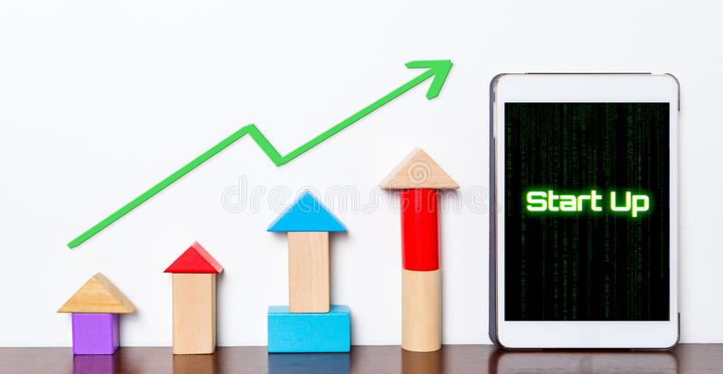 Start up Business success growing concept. On tablet. Toy block rise up with Start up Model planning stepping up diagram graph stock photo