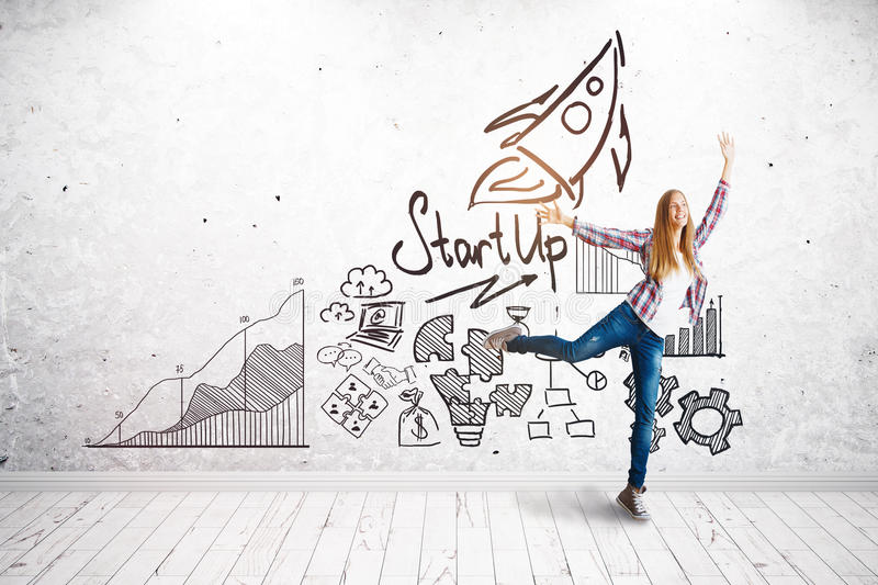Start up concept. Attractive european girl celebrating success in brick interior with business sketch on wall. Start up concept stock illustration