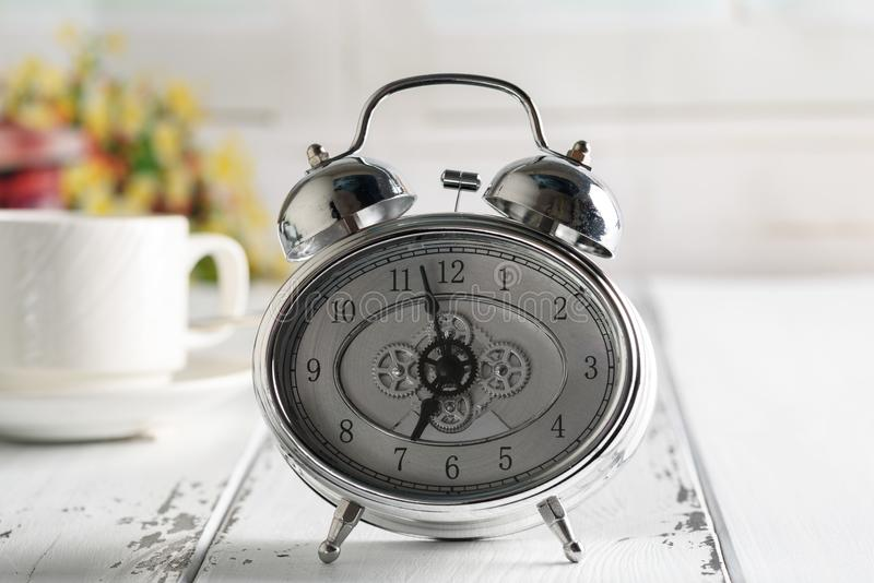 Start up concept.Coffe cup,alarm clock. Morning coffee day start royalty free stock images