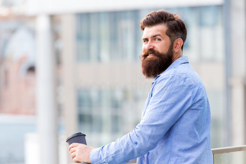 Start up concept. energy charge. Male barber care. copy space. thoughtful man drink take away coffee outdoor. morning royalty free stock photography
