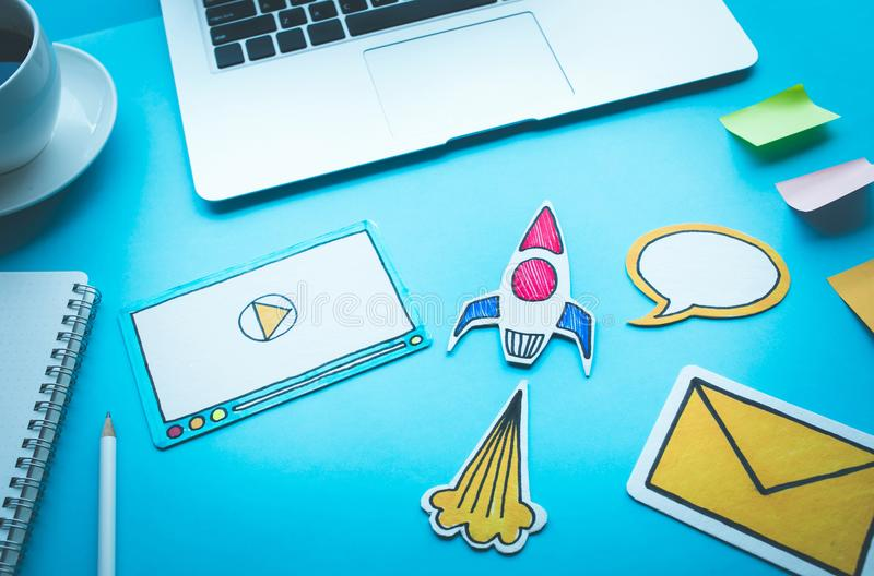 Start up concepts with rocket and digital symbol on desk table. Start up concepts with rocket and digital symbol on blue desk table.Investmet,success ideas stock photography