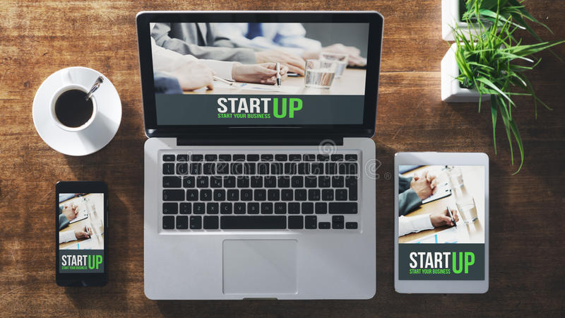 Start up corporate identity. Website on laptop, digital tablet and smart phone, business desktop royalty free stock photography