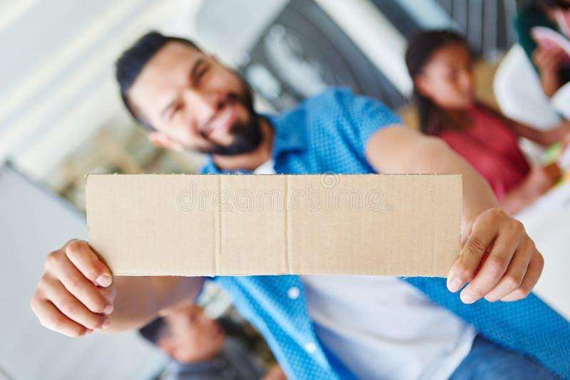 Start-up entrepreneur holding blank sign stock photo