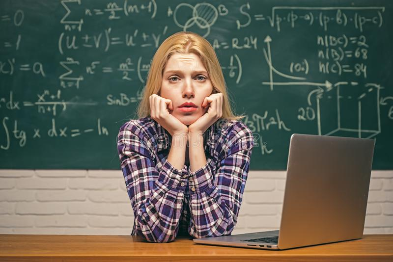 Start-up. Nerd funny student preparing for university exams. High school. Portrait of tired serious female student royalty free stock photo