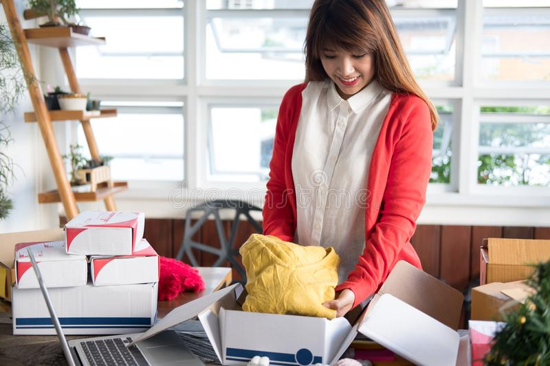 startup small business owner packing cloth in the box at workplace. freelance woman seller prepare product for packaging process royalty free stock photos