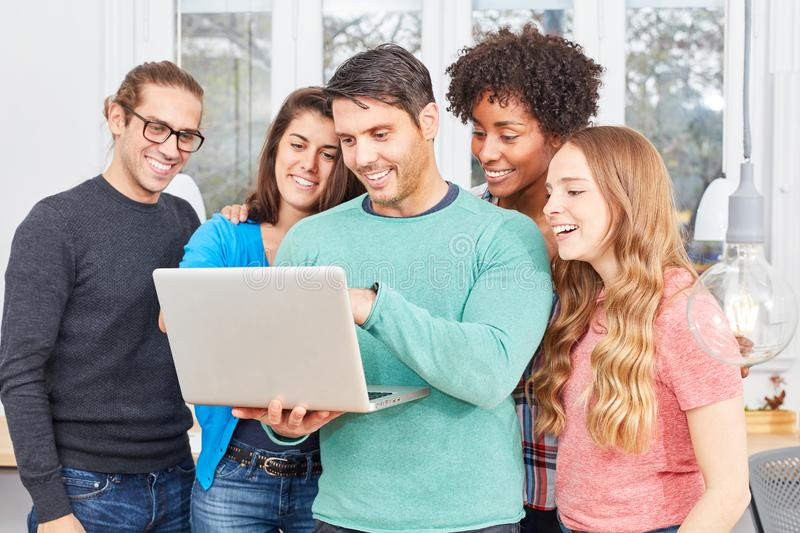 Start-up team with laptop during a video chat stock photography