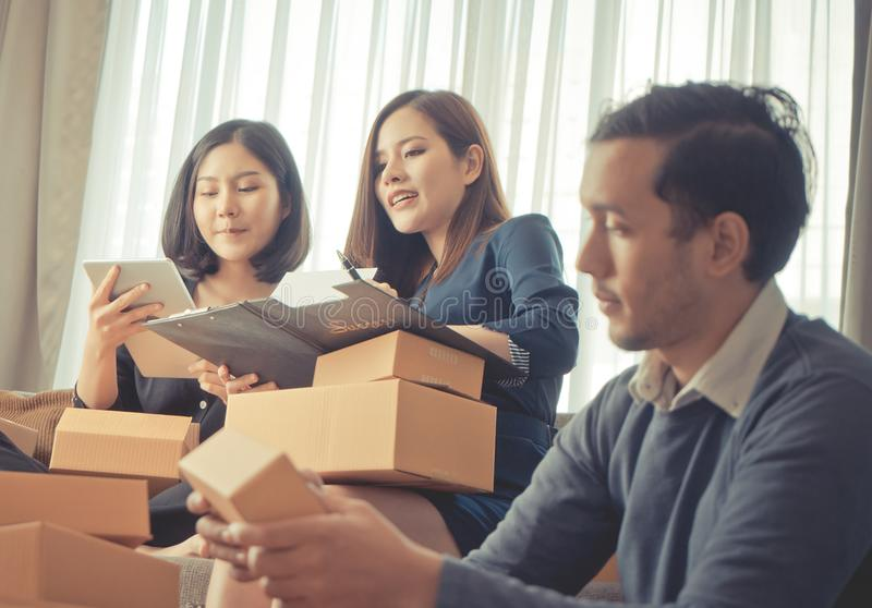 Start up team retailer packing boxes to send out to customer royalty free stock photo